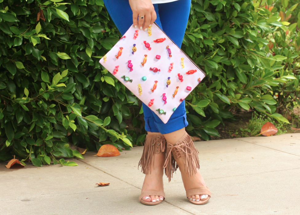 missyonmadison, melissa tierney, cobalt jeans, cobalt pants, tassel necklace, tassel beaded necklace, candy clutch, redbubble, redbubble clutch, candy printed clutch, fringe heels, tan fringe heels, fringe sandals, white topshop top, white chiffon cami, white chiffon camisole, how to wear cobalt, printed clutch, fringe heels, just fab, how to wear fringe heels, ray bans, blue aviators, blue ray bans, tassel trend, fringe trend, santa monica, la blogger, la, cali, california blogger, california, summer shoes, summer style, ootd, outfit inspo,