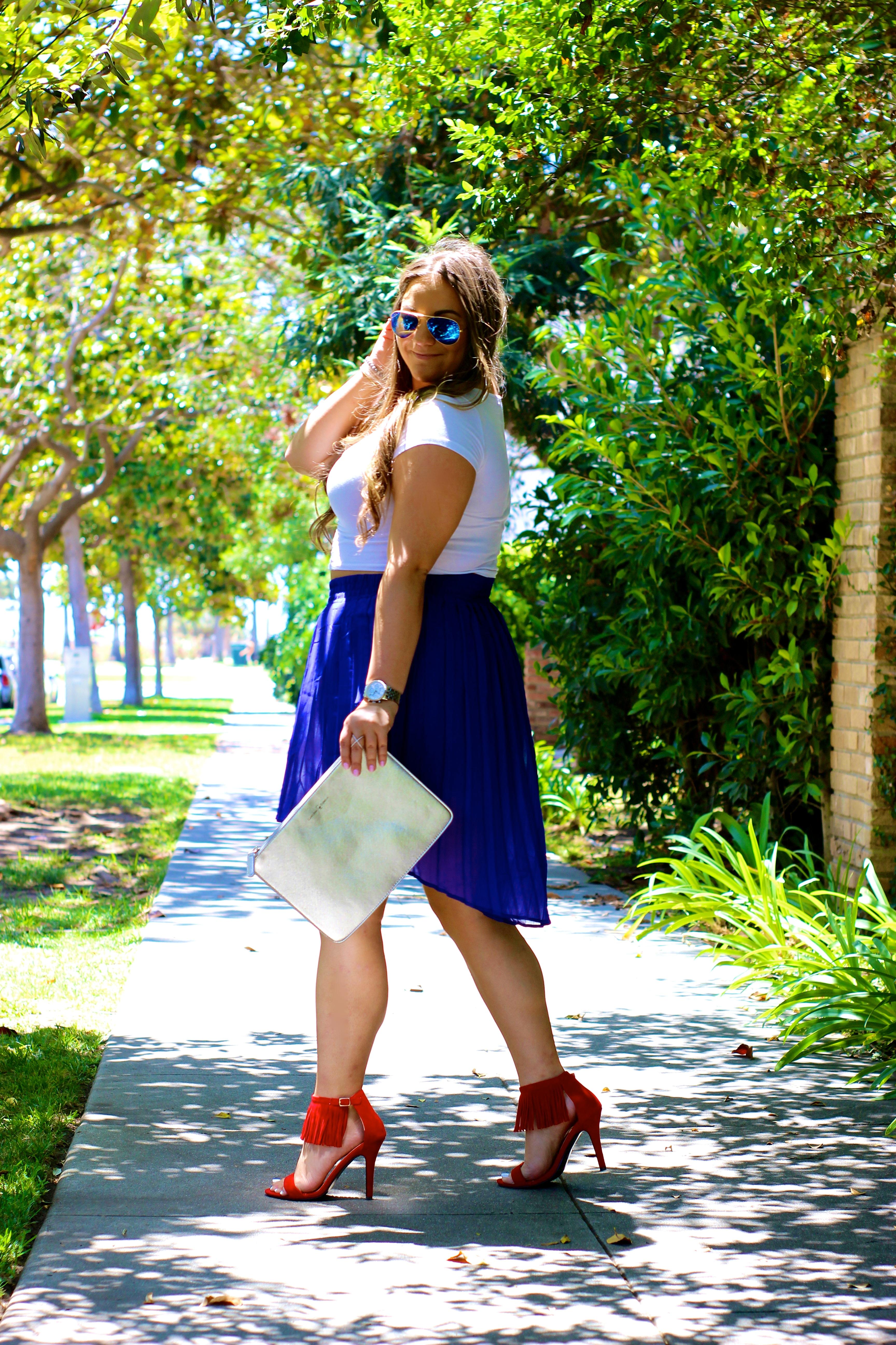 missyonmadison, love shopping miami, blue pleated skirt, blue pleated high low skirt, melissa tierney, fringe heels, red fringe heels, red fringe sandals, metallic silver clutch, silver clutch, ray bans, mirrored aviators, white crop top, metallic clutch, carolinna espinosa clutch, summer style, labor day weekend, labor day style, labor day, santa monica, la blogger, fashion blogger, style blogger,