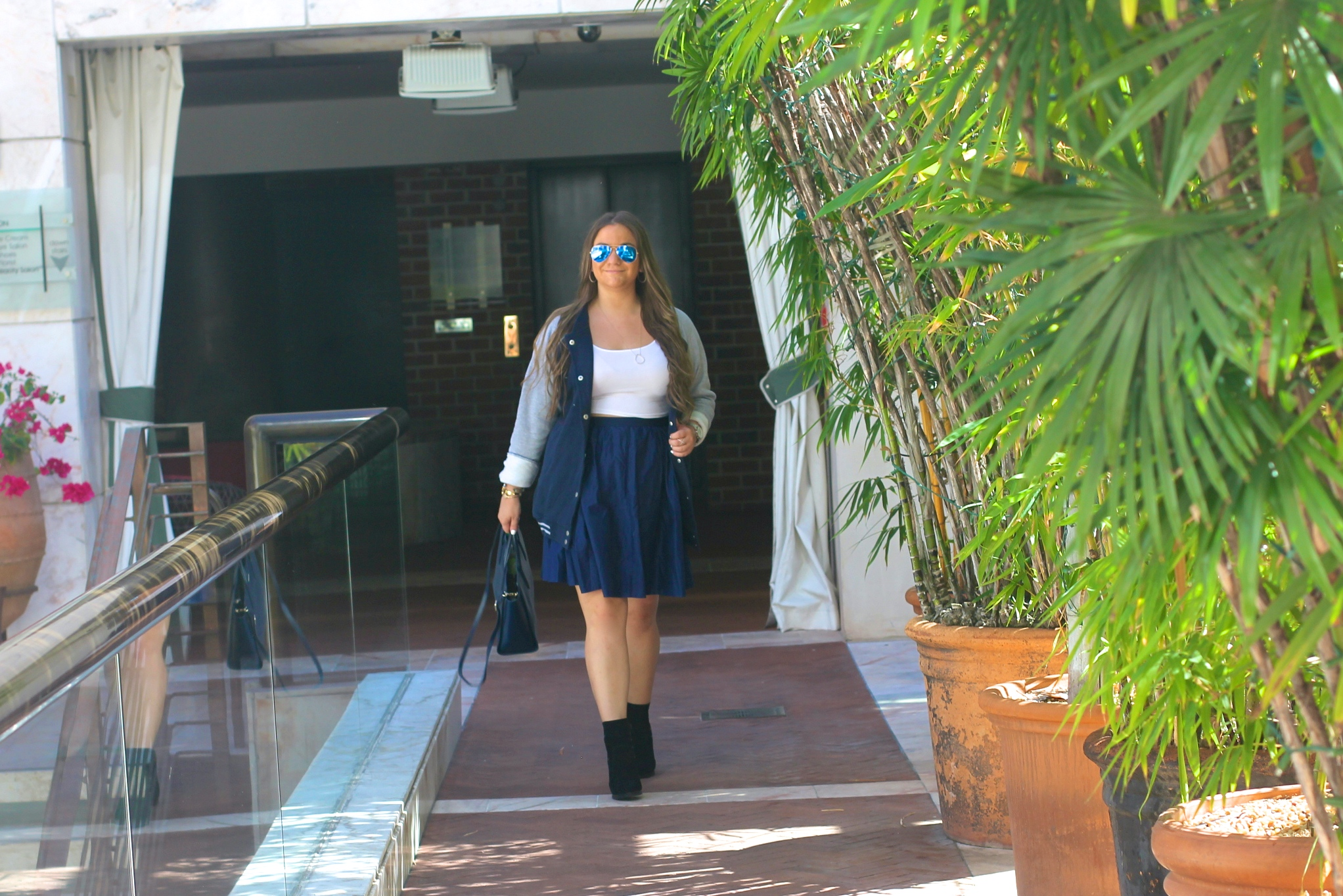 missyonmadison, melissa tierney, navy skirt, navy bomber jacket, navy satchel, lacoste satchel, white crop top, ray bans, mirrored aviators, navy idi skirt, uniqlo skirt, shoedazzle booties, black ankle booties, black booties, fall style, fall fashion, fashion blogger, bomber jacket,