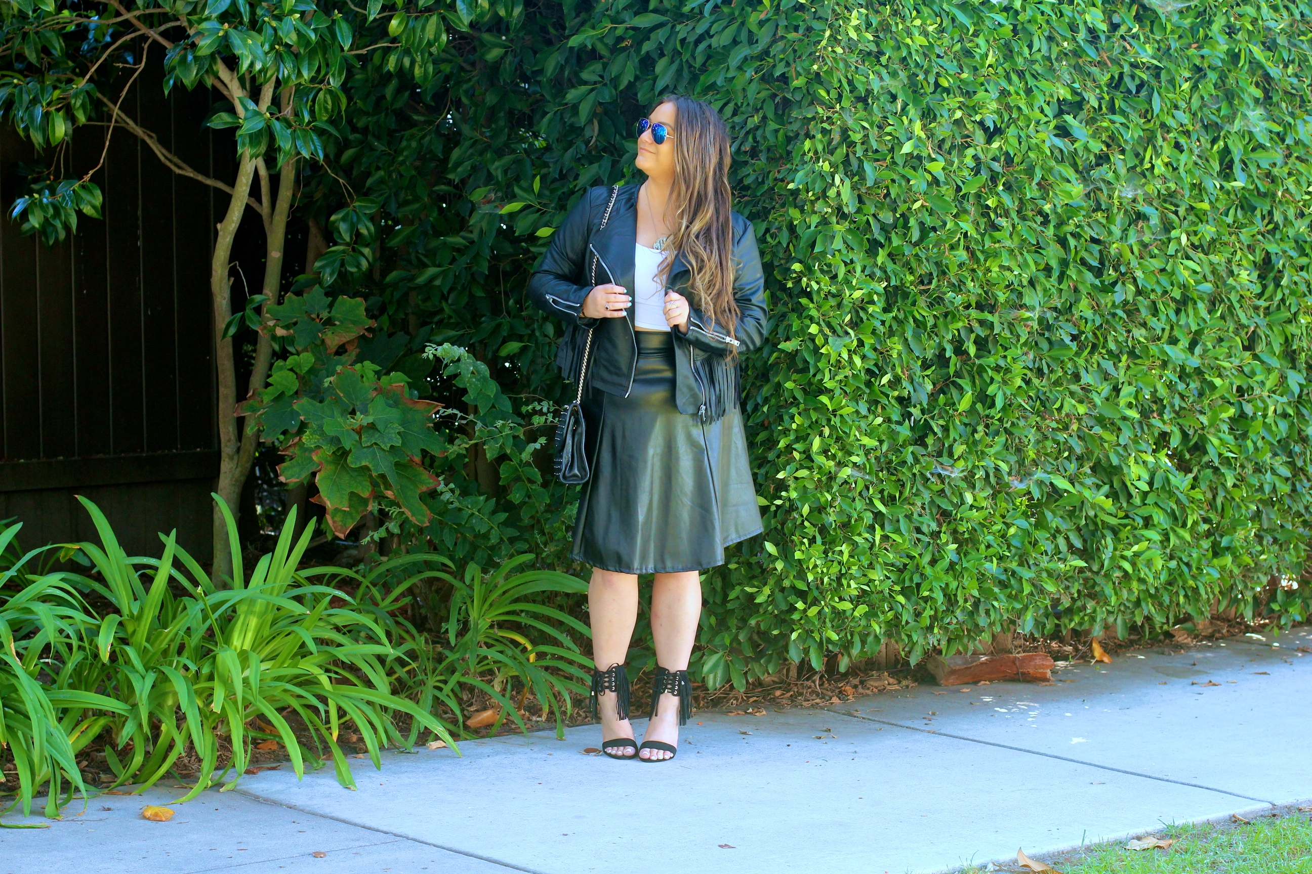 missyonmadison, melissa tierney, fringe leather jacket, coffee shop coats, leather fringe coffee shop coats, ray bans, mirror aviators, black quilted bag, rebecca minkoff affair bag, black rebecca minkoff affair bag, black fringe heeled sandals, black fringe heels, fringe heels, white crop top, black leather midi skirt, black midi skirt, faux leather skirt, holiday style, outfit inspo, ootd, holiday outfit inspo, thanksgiving outfit, fringe trend, how to wear fringe, style blogger,