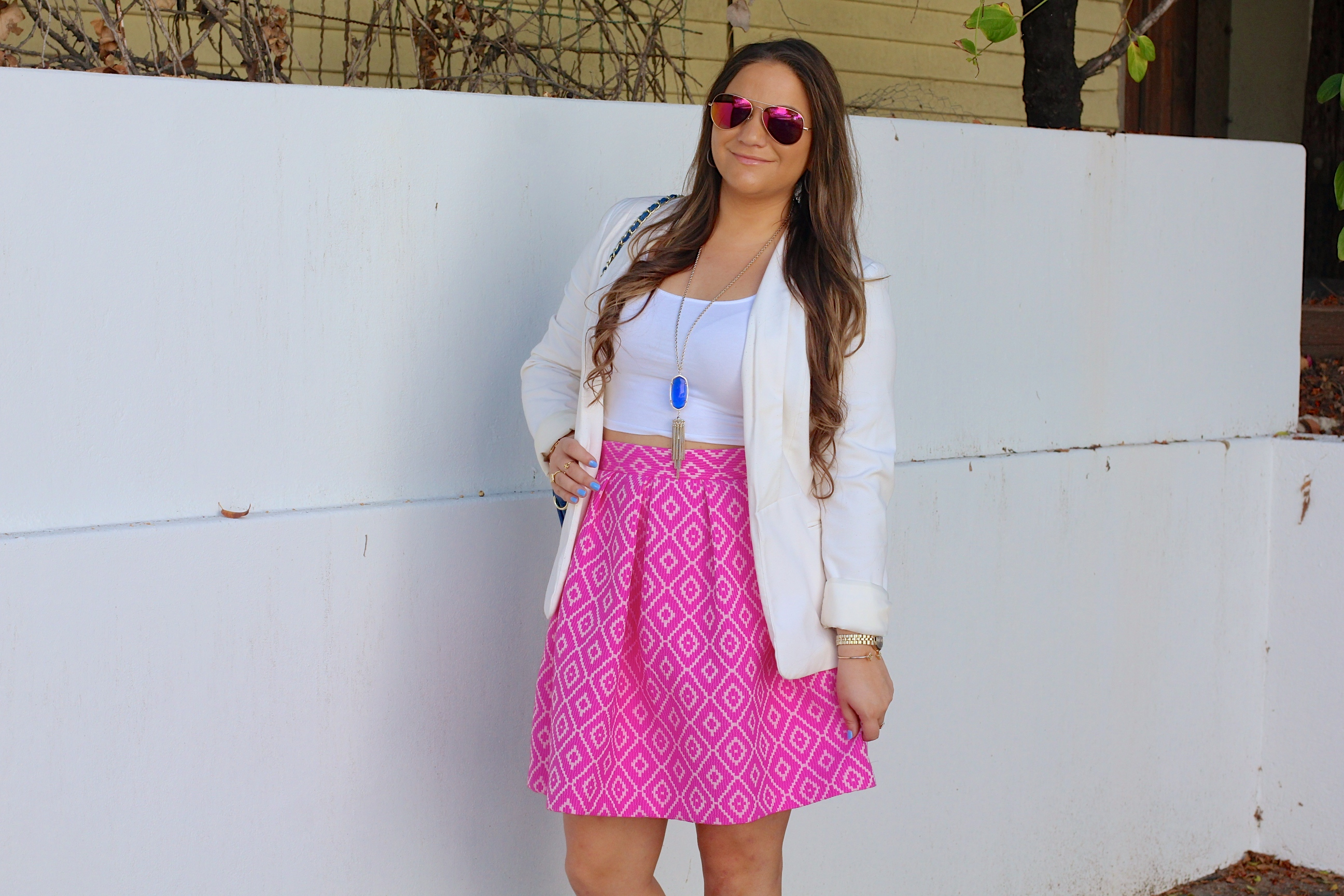 missyonmadison, melissa tierney, hutch design, pink midi skirt, pink printed skirt, white crop top, white boyfriend blazer, white blazer, ray bans, pink aviators, pink ray bans, kendra scott, kendra scott rayne necklace, blue quilted bag, cobalt quilted bag, cobalt bag, gray pumps, gray pointed toe pumps, brunette hair, la blogger, fall style, ootd, outfit inspo, street style, pop of color, colorful outfits, midi skirt, statement piece,