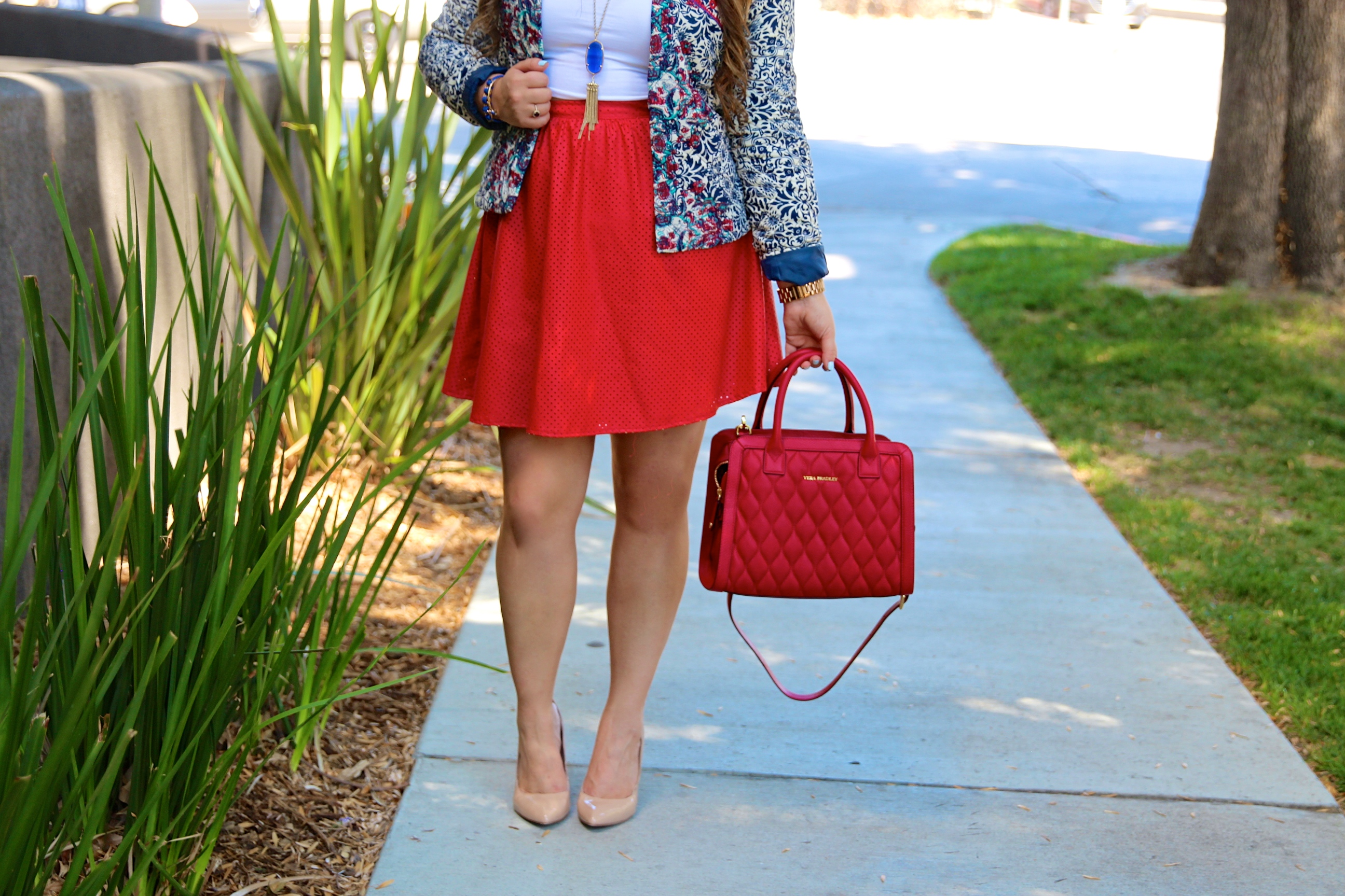 missyonmadison, melissa tierney, shabby apple, shabby apple jacket, embroidered jacket, cropped jacket, cropped printed blazer, red faux leather skirt, red a line skirt, nude pumps, steve madden pumps, nude pointed toe pumps, vera bradley, red vera bradley satchel, kendra scott rayne necklace, kendra scott necklace, white crop top, go jane crop top, ray bans, red mirrored aviators, red sunglasses, printed cropped jacket, brunette hairstyle, curled hair, red skirt, holiday style, fashion blogger, outfit inspo, ootd, fashion blogger, la blogger, vera bradley style,