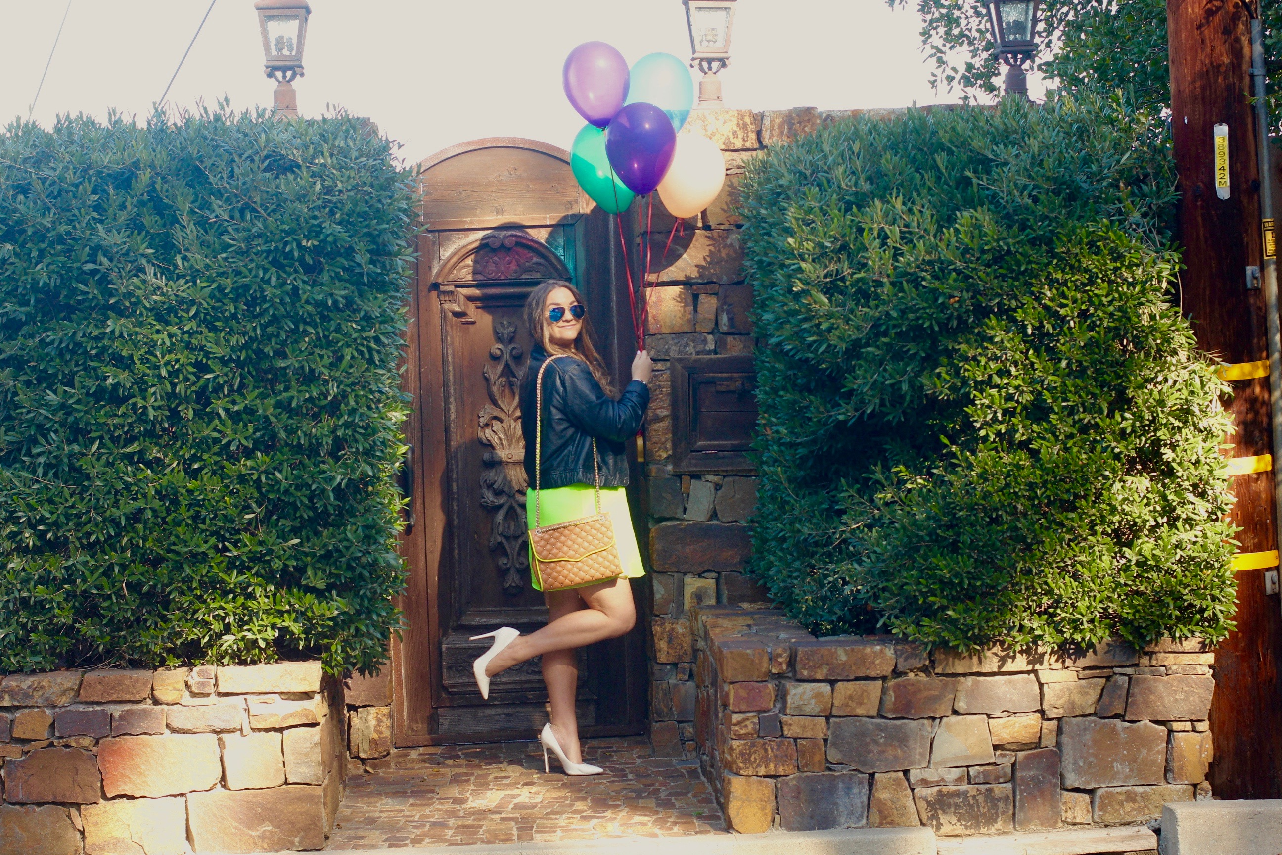 missyonmadison, melissa tierney, fashion blogger, fashion blogger, turning 24, birthday, birthday outfit, la blogger, neon dress, green neon dress, black moto jacket, leather jacket, leather motorcycle jacket, white pumps, white pointed toe pumps, brown quilted cross body bag, rebecca minkoff affair bag, tan quilted cross body bag, ray bans, blue mirrored ray bans, gold cuff bracelet, gold lariat necklace, universal city overlook, balloons, birthday girl, brunette hair,