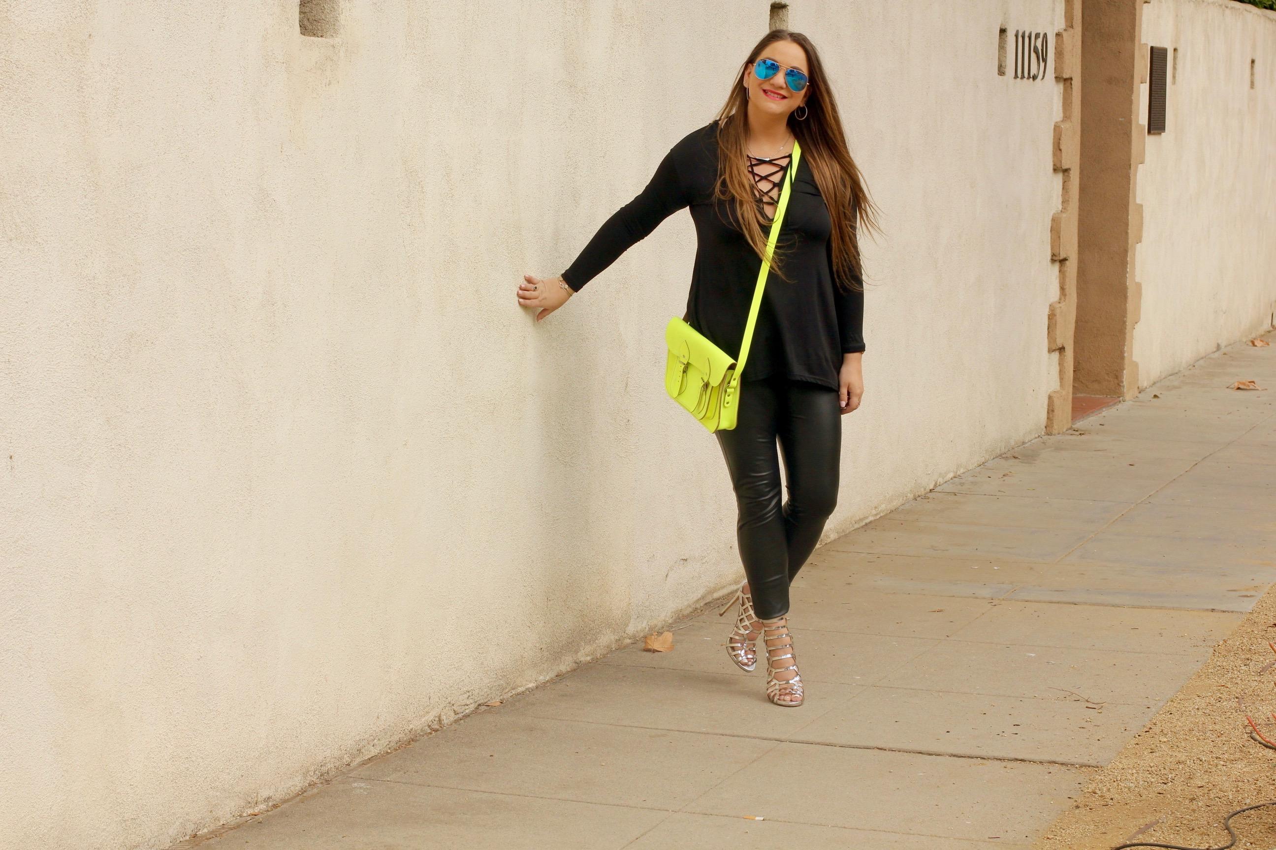 missyonmadison, melissa tierney, hue leggings, heatherette leggings, vegan leather leggings, black leather leggings, silver gladiator sandals, silver caged heels, silver gladiator heels, black long sleeve going out top, black long sleeve caged top, ray bans, mirrored ray bans, red lipstick, brunette hairstyle, leather leggings, la style, fashion blogger, fashion blog, style blogger, black long sleeve criss cross top, neon cambridge satchel, neon satchel, yellow cambridge satchel, date night outfit,