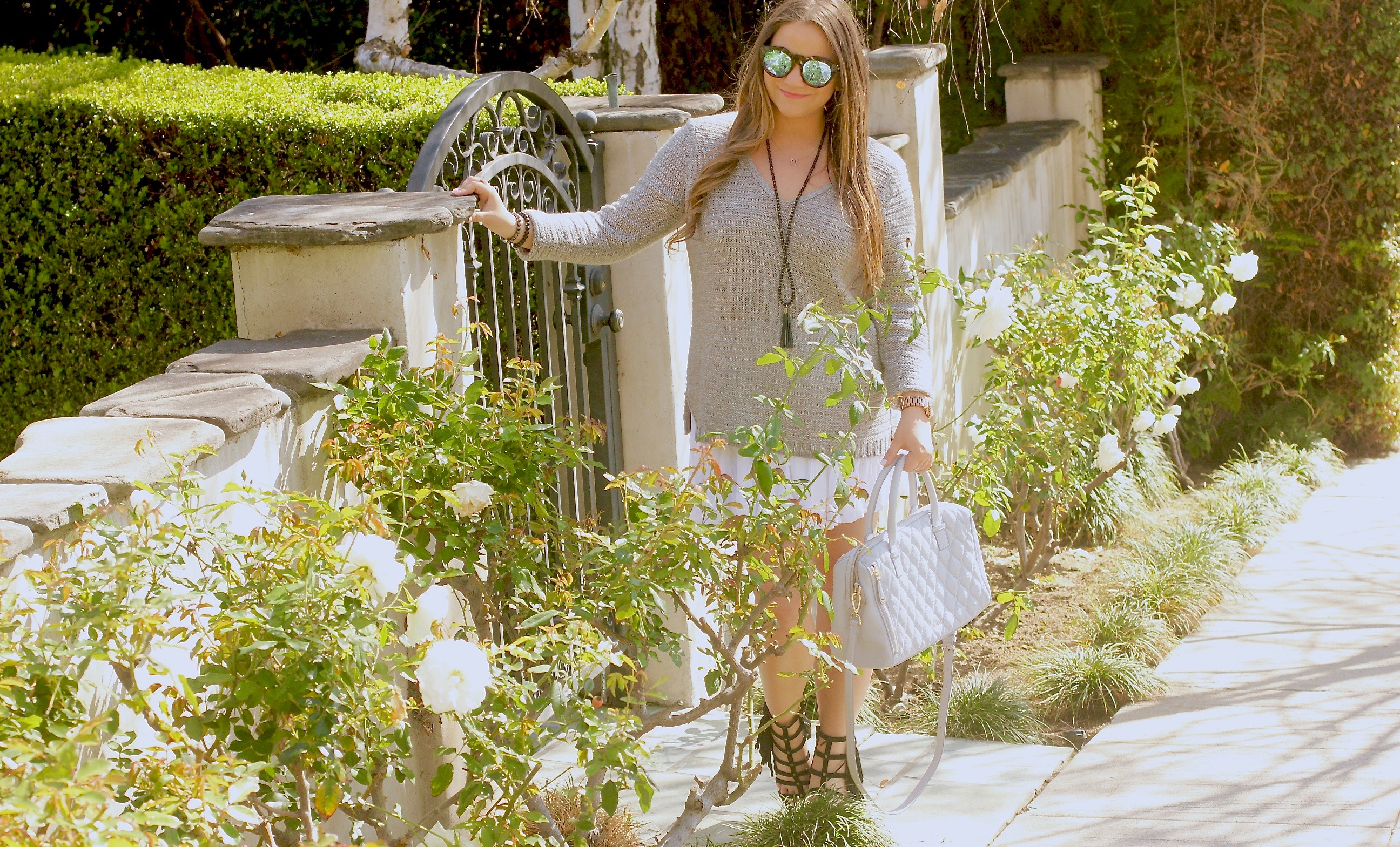 missyonmadison, melissa tierney, gray v neck sweater, gray sweater, white skirt, white pleated skirt, white skater skirt, le specs sunglasses, vera bradley satchel, vera bradley bag, gray vera bradley satchel, marrin costello jewelry, back fringe necklace, black fringe sandals, black heeled gladiator fringe sandals, la style, spring style, spring trends, winter style, la blogger, fashion blogger,