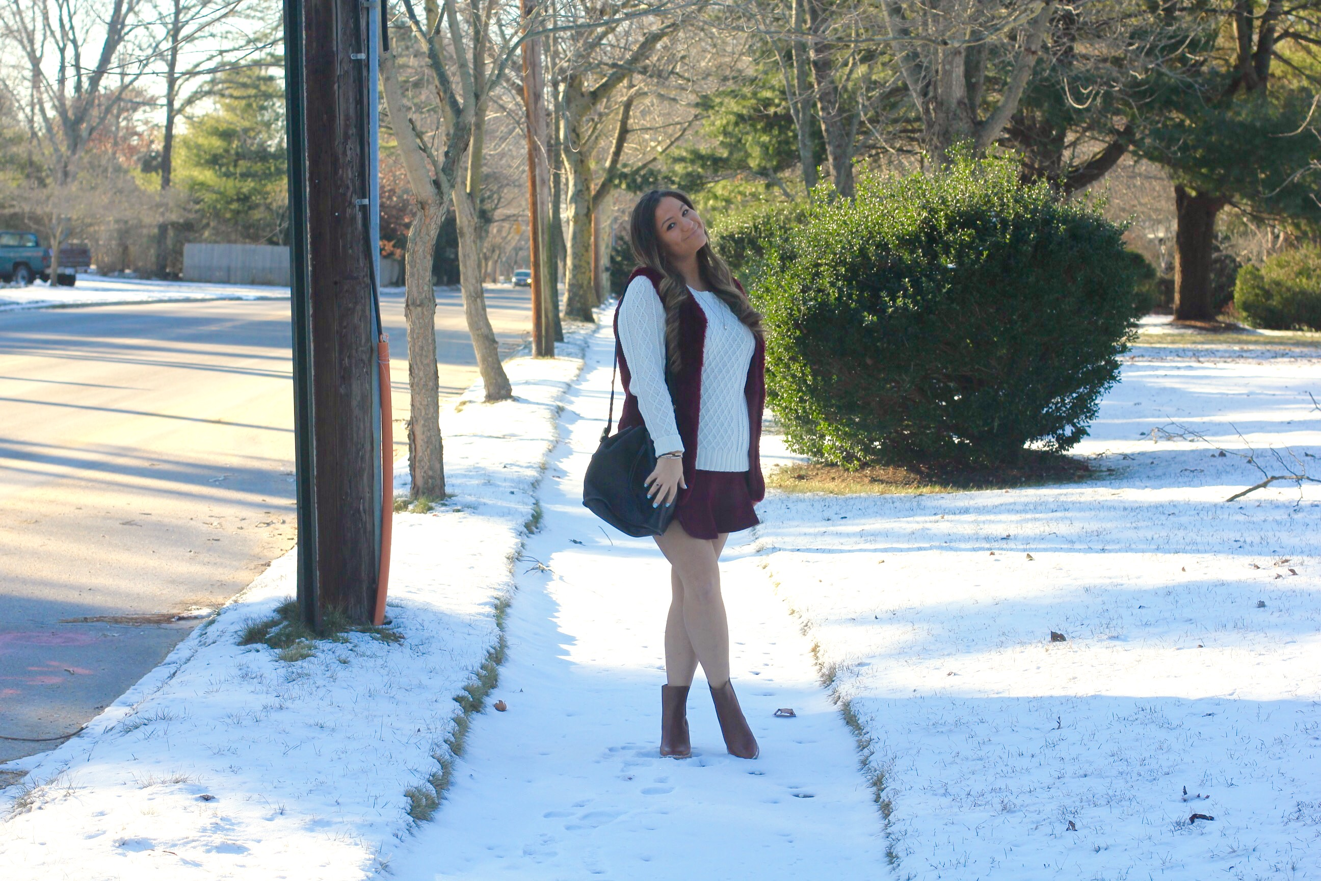 missyonmadison, melissa tierney, la blogger, winter style, ny blizzard, snow day style, tan leather heeled boots, maroon skater skirt, maroon faux fur vest, maroon vest, winter hair style, anne klein watch, black leather bucket bag, heeled ankle boots, white cable knit sweater, womens white cable knit sweater, ny blogger, tbt, throwback thursday, winter hair trends, brunette hair style, snow style, how to wear maroon,