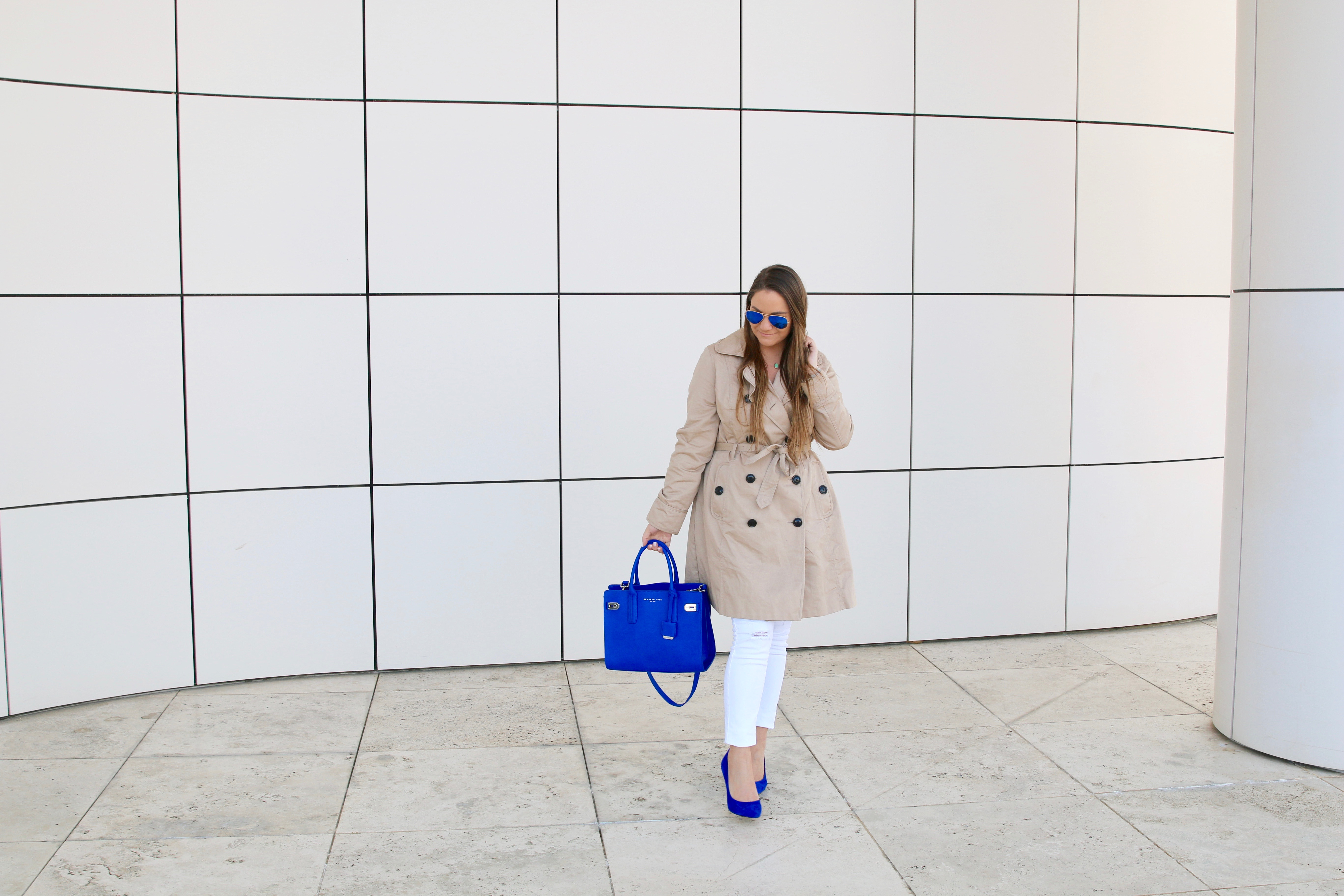 missyonmadison, melissa tierney, cobalt blue satchel, cobalt blue pumps, blue pumps, cobalt blue suede pumps, white skinny jeans, old navy, old navy white skinny jeans, trench coat, spring style, la blogger, la style, white old navy rockstar jeans, white old navy skinny jeans, kenneth cole bag, ray bans, blue ray bans, mirrored aviators, blue mirrored ray bans, brunette hair, fashion blogger, fashion blog,