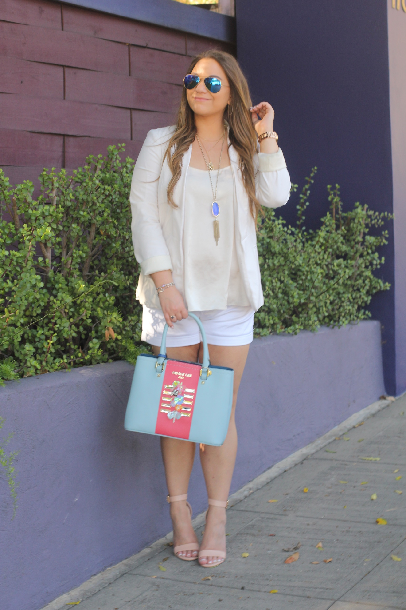 missyonmadison, spring style, melissa tierney, white boyfriend blazer, womens white boyfriend blazer, nicole lee usa, nicole lee usa tote, floral bag, floral satchel, baby blue leather tote, spring handbags, spring trends, nude ankle strap heels, nude ankle strap sandals, nude chunky heels, spring shoes, white chiffon camisole, topshop camisole, white cotton shorts, white shorts, white dress shorts, white suit, short suit, how to style shorts for spring, ray bans, blue mirrored aviators, kendra scott, blue kendra scott rayne necklace, michael kors blue watch, michael kors cobalt watch, la style, la blogger,