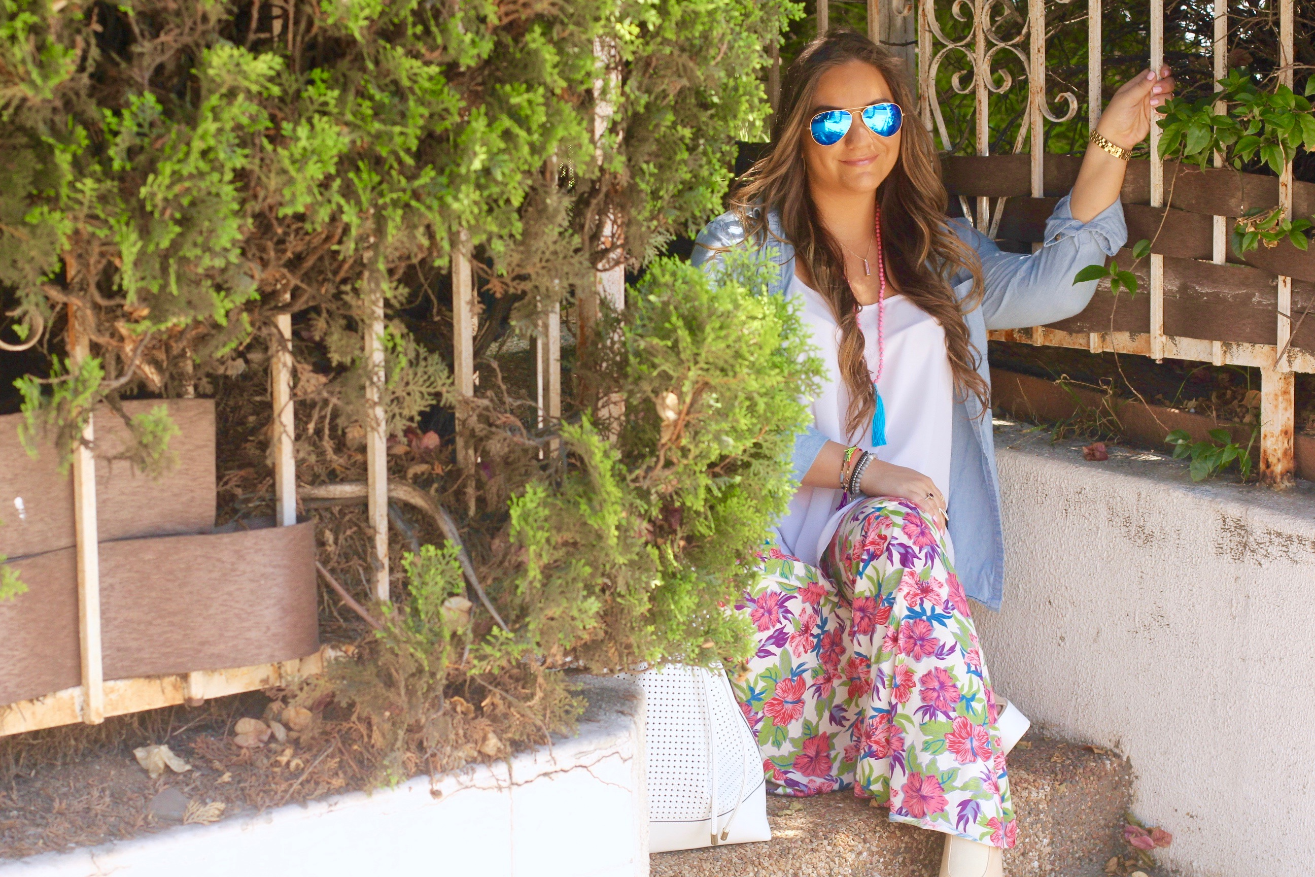 missyonmadison, melissa tierney, white bucket bag, vince camuto bucket bag, floral bell bottoms, floral pants, coachella style, coachella vibes, boho chic trends, tassel necklace, ray bans, sunglasses, ray bans, mirrored aviators, chambray shirt, button down chambray shirt, chambray shirt, white chiffon camisole, kohls, apt 9 georgette top, platform heels, ami clubwear,