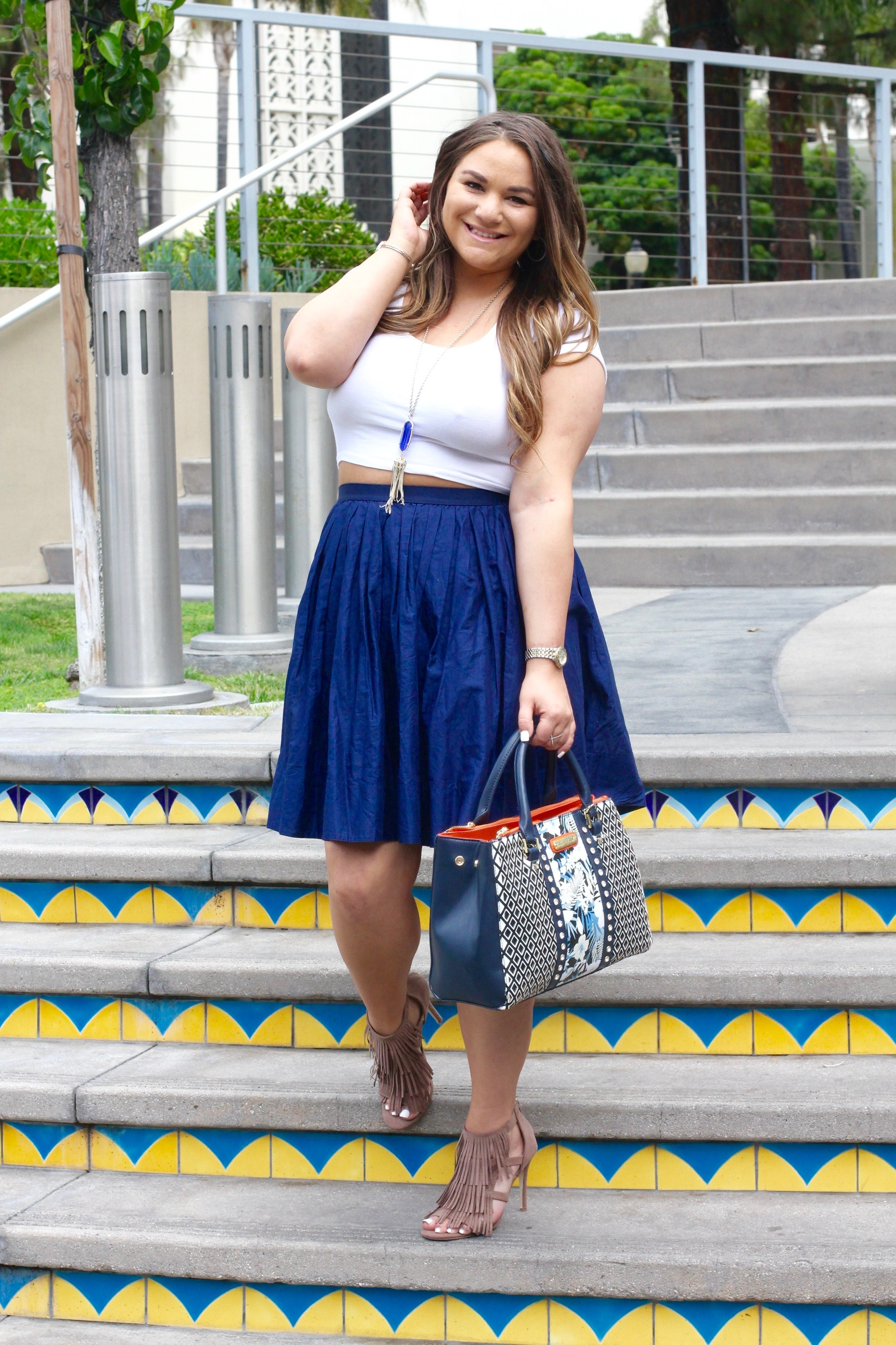 missyonmadison, melissa tierney, fashion blog, fashion blogger, style blogger, style blog, style guide, navy blue skirt, navy blue midi skirt, uniqlo skirt, nicole lee usa bag, nicole lee bag, floral tote, outfit inspo, spring style, white crop top, white denim jacket, old navy denim jacket, kendra scott rayne necklace, ami clubwear, tan fringe heels, fringe heels, how to wear a midi skirt, burbank california, moving,