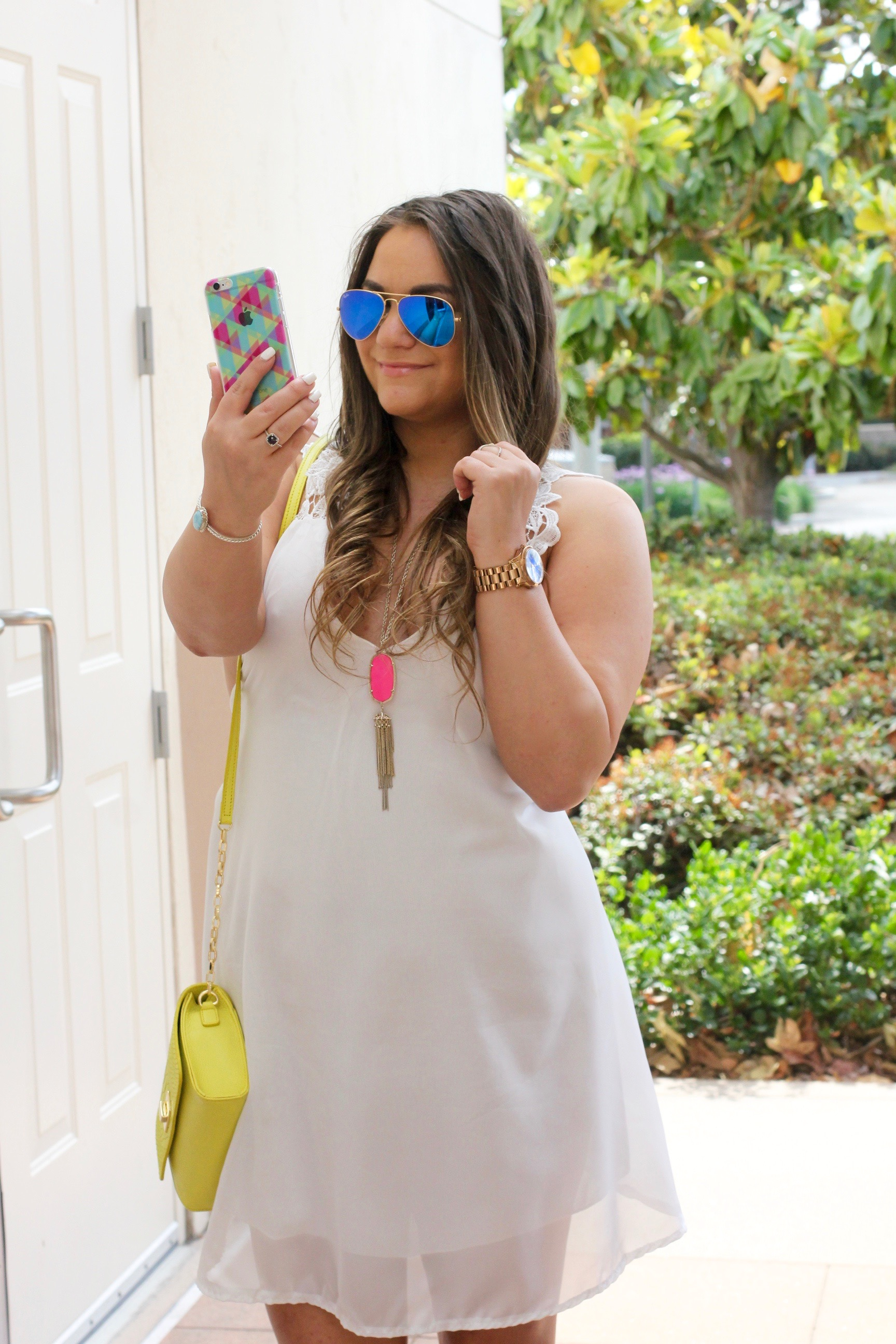 missyonmadison, melissa tierney, fashion blog, fashion blogger, style blog, style blogger, lwd, little white dress, nina shoes, floral heels, colorful heels, summer style, gigi ny, gigi ny crossbody, neon yellow bag, yellow crossbody bag, ray bans, kendra scott necklace, kendra scott rayne necklace, pink tassel necklace, white open back dress, white criss cross dress, colorful heeled sandals, la blogger, brunette hair, summer style,
