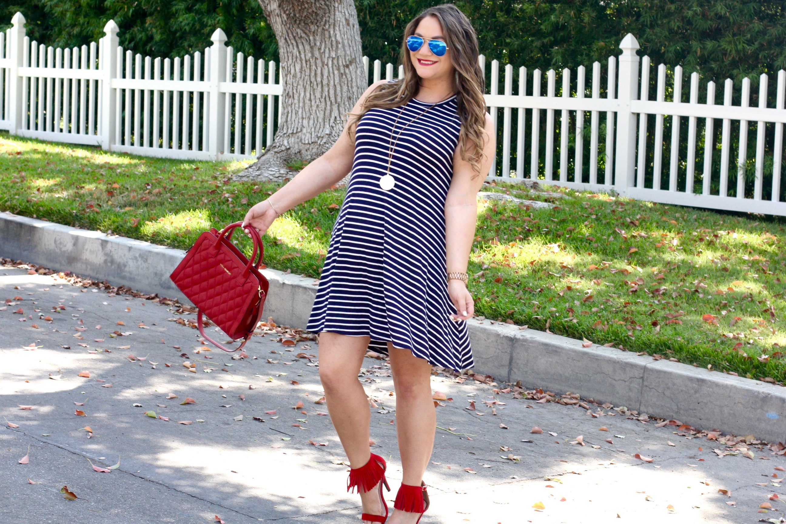 missyonmadison, melissa tierney, fashion blogger, la blogger, la style, what to wear for the 4th of july, july 4th, july 4th weekend, 4th of july weekend, red fringe ankle strap heels, red fringe heels, red fringe sandals, patriotic style, a byer dress, navy and white striped dress, navy striped dress, red quilted bag, vera bradley, red vera bradley satchel, ray bans, blue mirrored aviators, outfit inspo for the 4th of july, how to wear stripes,