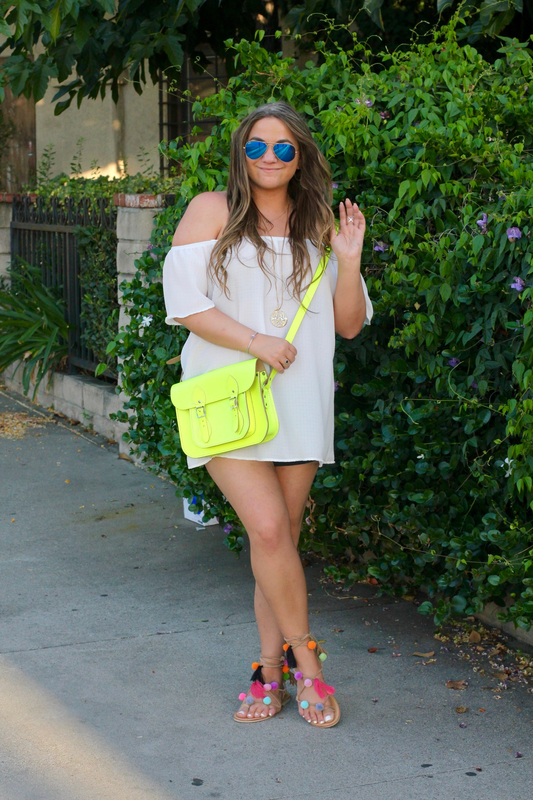 missyonmadison, melissa tierney, fashion blog, fashion blogger, style blogger, la blogger, summer style, pom pom sandals, pom pom flats, summer trend, summer sandals, off the shoulder top, white off the shoulder blouse, cambridge satchel, neon cambridge satchel, ray bans, mirrored aviators ray bans, off the shoulder blouse, cali girl, brunette hair, hairstyle,