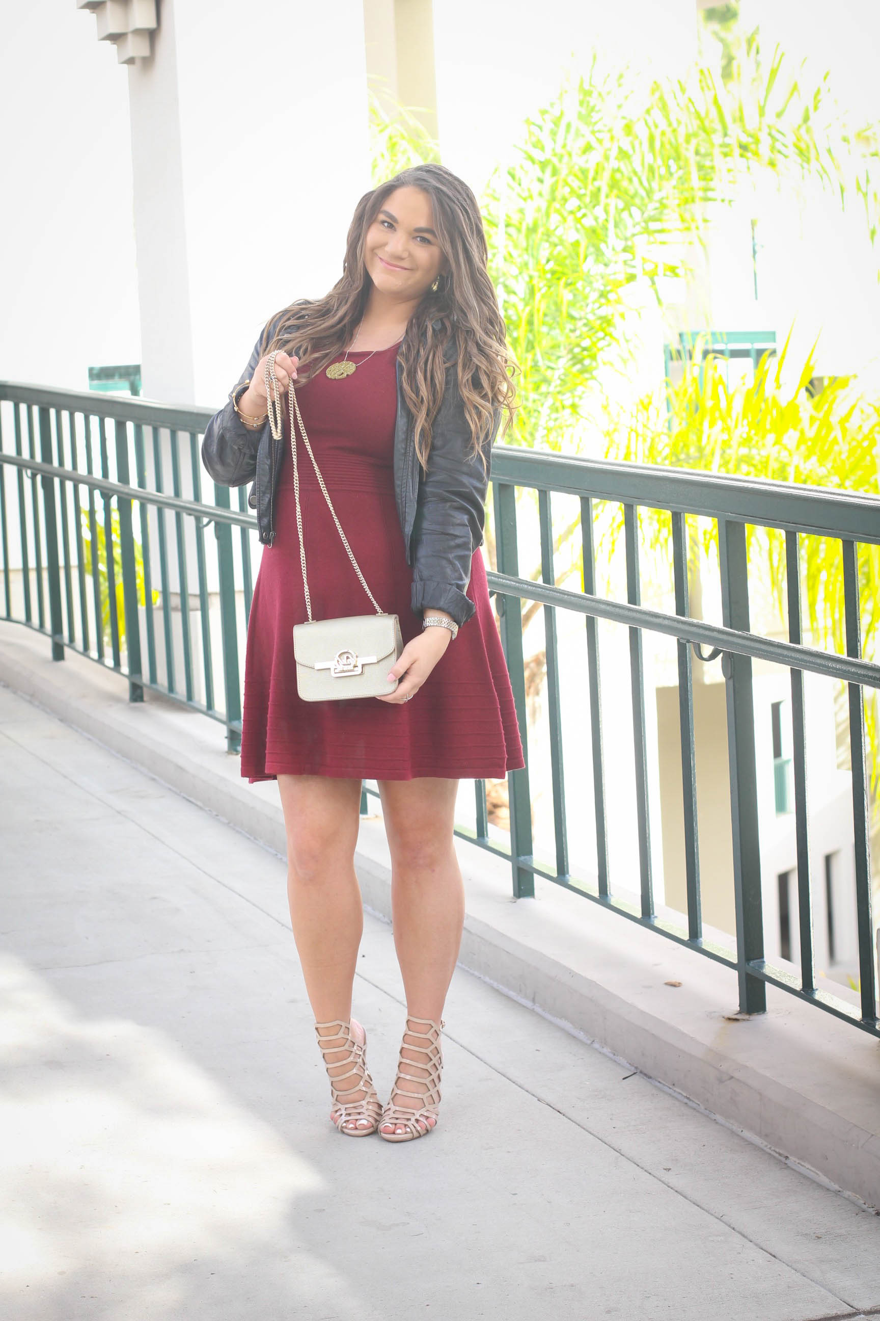 missyonmadison, sweater dress, how to style a sweater dress, how to style a moto jacket, moto jacket, maroon dress, maroon sweater dress, caged heels, nude gladiator heels, gold crossbody bag, gold bag, mezzanotte bag, nude heels, nude caged heels, holiday dress guide, what to wear for the holidays, christmas outfit ideas, melissa tierney, sweater dress,