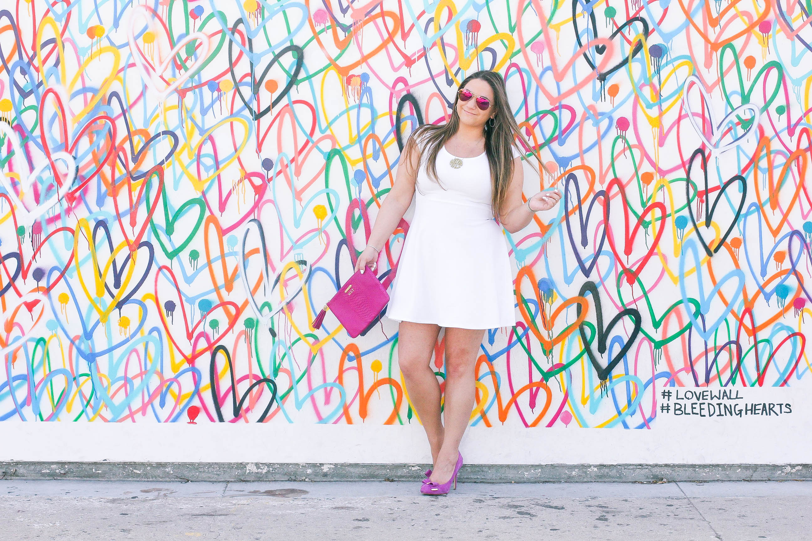 missyonmadison, melissa tierney, missy on madison instagram, pink pumps, pink bow pumps, michael kors heels, fuschia pink pumps, fuschia pumps, white dress, white fit and flare dress, gigi ny, gigi ny magenta clutch, pink clutch, pink ray bans, pink aviators, monogram necklace, heart wall, abbot kinney, venice, heart wall venice, vday, valentines day, valentines day style,