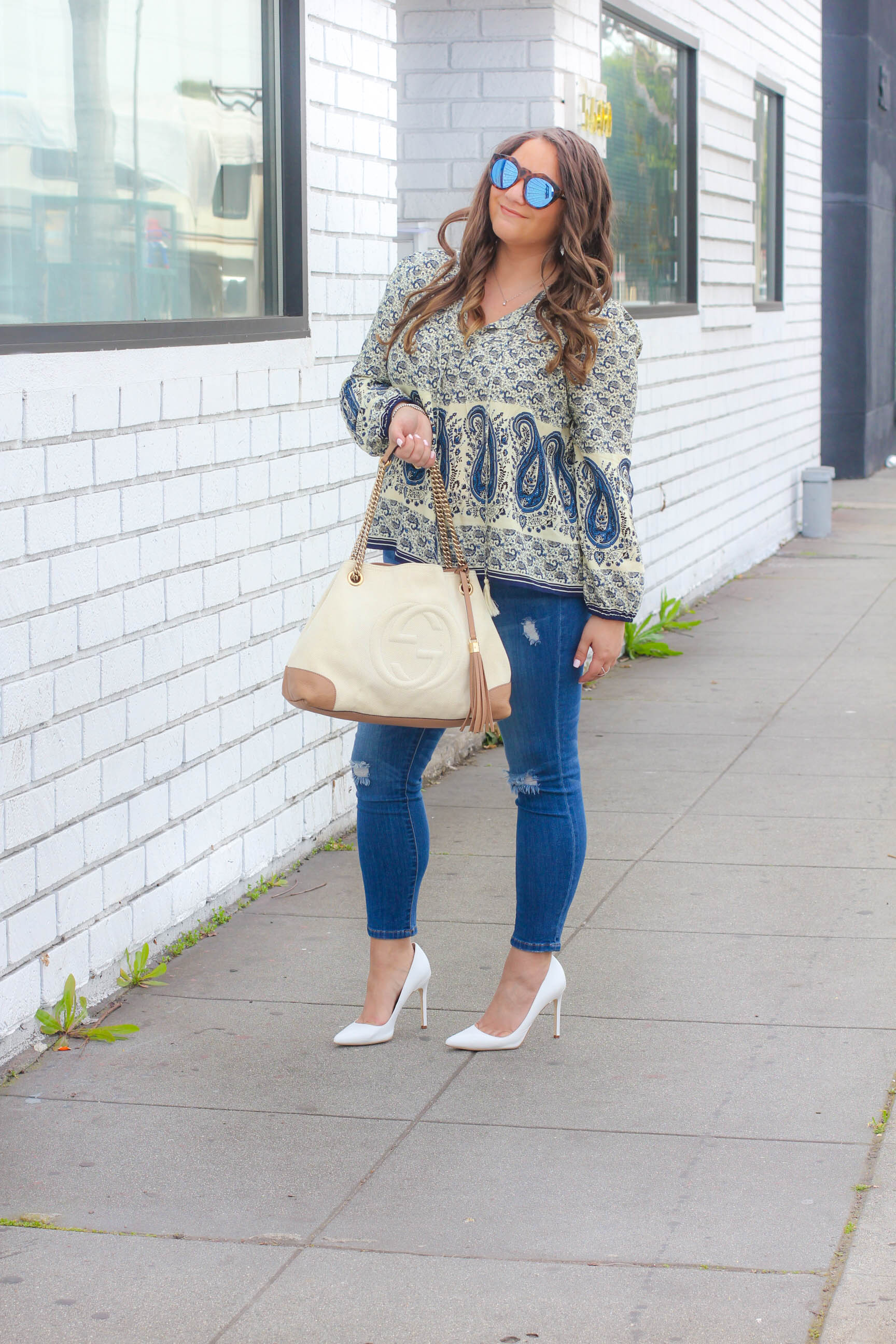 missyonmadison, melissa tierney, missyonmadison instagram, melissa tierney instagram, wild blue denim, white pumps, white pointed toe pumps, gucci, gucci soho tote, white gucci soho tote, bloglovin, fashion blogger,style blogger, spring style, spring trends 2017, spring style 2017, jeggings, wild blue jeggings, ripped jeans, reipped jeggings, fashion trends, le specs sunglasses, le specs, wild blue denim boho top, paisley print top, boho top, how to style skinny jeans, how to style white pumps, how to style distressed jeans, la blogger, affordable fashion,