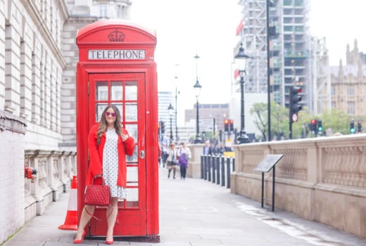 missyonmadison, melissa tierney, missyonmadison instagram, bloglovin, la blogger, travel blog, travel blogger, big ben, london, london eye, red phone booth, red london phone booth, phone booth, red button down coat, red satchel, red leather satchel, red pumps, calvin klein pumps, calvin klein red pumps, red suede pumps, fashion blogger, style blog, style blogger, polka dot dress, white polka dot dress, old navy polka dot dress, mirrored aviators,