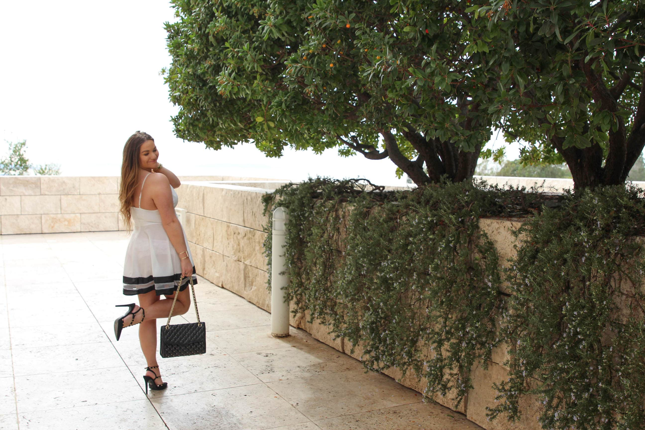 missyonmadison, missyonmadison instagram, missyonmadison blog, la blogger, fashion blogger, style blogger, style diaries, bloglovin, white skater dress, white a line dress, rockstud heels, rockstud pumps, black rockstud pumps, rebecca minkoff bag, rebecca minkoff affair bag, valentines day style, vday style, vday 2018, valentines day 2018, what to wear for valentines day, the getty, date night style, date night looks, rockstud look alikes, valentino rockstud pumps,