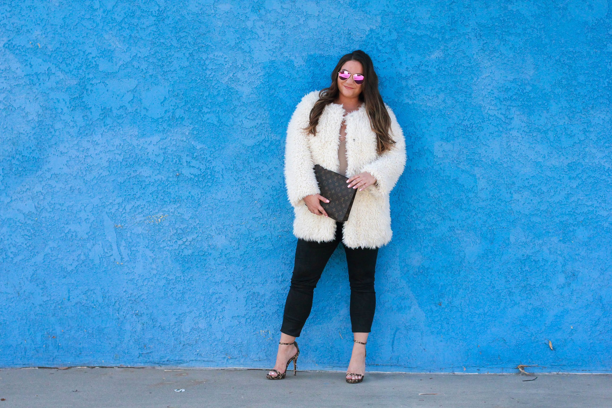 missyonmadison, missyonmadison blog, missyonmadison instagram, fashion blog, fashion blogger, white fuzzy coat, white coat, kendall and kylie coat, kendall and kylie fuzzy coat, leopard ankle strap sandals, leopard heels, leopard ankle strap heels, spanx, spanx leggings, spanx leather leggings, diff eyewear, diff eyewear pink aviators, pink aviators, bloglovin, la blogger, style blog, style blogger, melissa tierney, winter style, winter style inspo, winter outfit ideas, date night outfit, shaggy coat, fuzzy coat, teddy bear coat, v neck body suit, nude v neck body suit, louis vuitton clutch, louis vuitton toiletry pouch 26, louis vuitton toiletry pouch, style inspo,