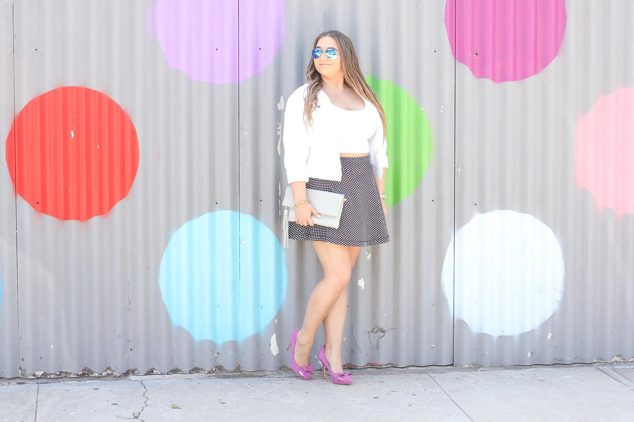 missyonmadison, polka dot skirt, polka dot wall, la blogger, fall style, fall fashion, fall blogger, currently wearing, melissa tierney, melissa tierney instagram, pink pumps, gigi new york, gigi new york clutch, fuschia pumps, pink bow pumps, michael kors heels, michael kors pumps, polka dot skirt, white moto jacket, white crop top, white short sleeve crop top, how to style polka dots,