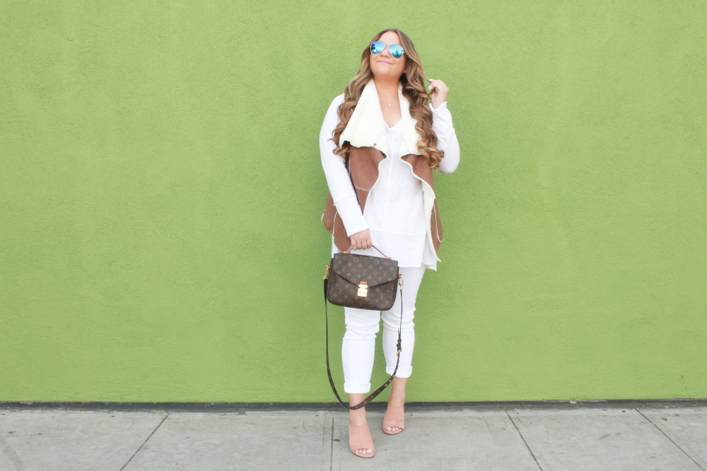 missyonmadison, missyonmadison blog, missyonmadison blogger, la blogger, melissa tierney, missyonmadison instagram, winter white, white after labor day, sherpa vest, tan sherpa vest, how to style a vest, how to style a sherpa vest, long sleeve cotton blouse, white long sleeve cotton top, white skinny jeans, white jeans, old navy rockstar jeans, old navy white skinny jeans, bloglovin, louis vuitton bag, louis vuitton pouchette metis, stuart weitzman, stuart weitzman mules, stuart weitzman sequel mules, suede peep toe mules, style inspo, fall style, fall 2018 style, fall 2018 trends, winter style, winter 2018 style,