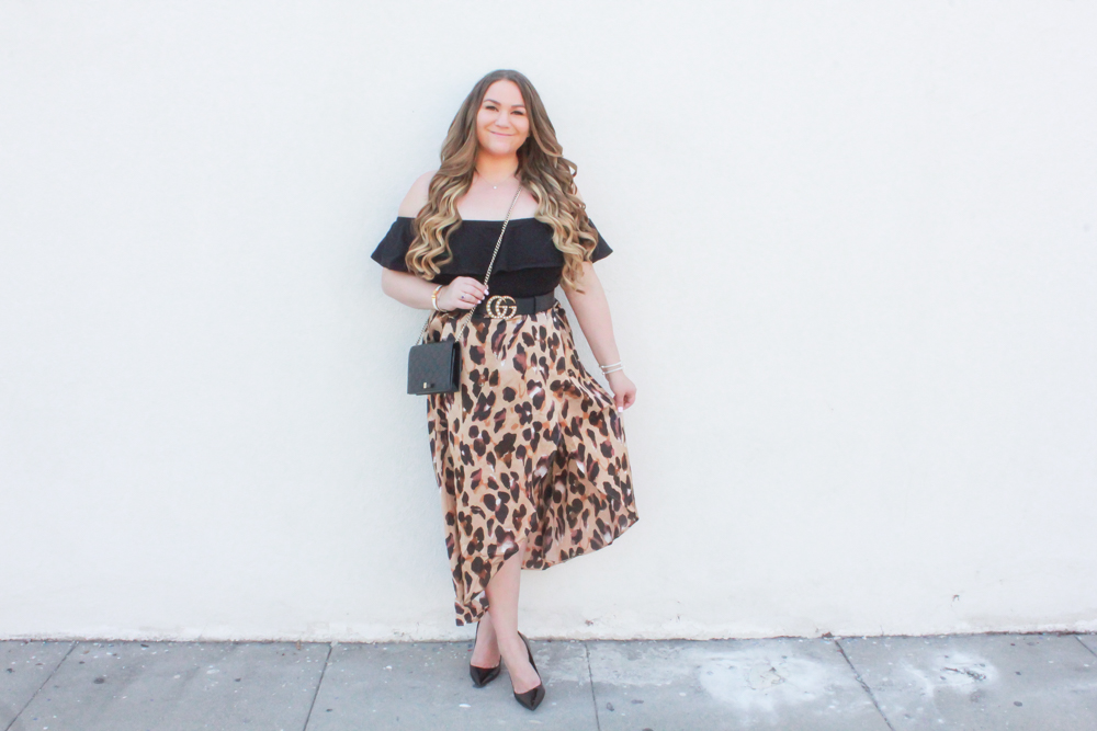 missyonmadison, missyonmadison blog, missyonmadison instagram, leopard print for spring, styling leopard print, la blogger, spring outfit ideas, black patent leather pumps, leopard wrap skirt, leopard skirt, outfit ideas, leopard trend, gucci mini bag, gucci chain on wallet, black ruffle bodysuit, black off the shoulder bodysuit, gucci pearl belt, gucci belt, shein, shein leopard skirt, ootd, style inspo, spring style ideas,