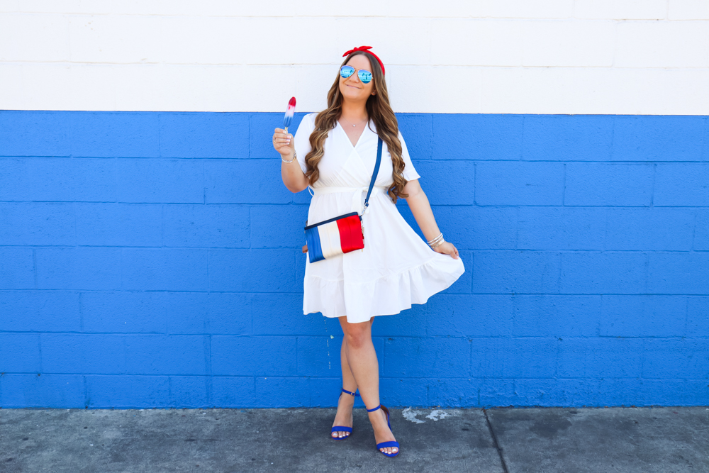 missyonmadison, missyonmadison blog, la blogger, bloglovin, missyonmadison isntagram, american flag purse, red white and blue, white wrap dress, shein white wrap dress, shein white dress, blue heels, blue sandals, blue ankle strap heels, blue ankle strap sandals, rocket pop, rocket pop purse, summer outfit inspo, summer outfits, 2019 summer outfit, 2019 summer style, 4th of july outfit ideas, 4th of july outfit inspo, red white and blue outfit, raybans, red headband, red bow headband , red bow hairband,