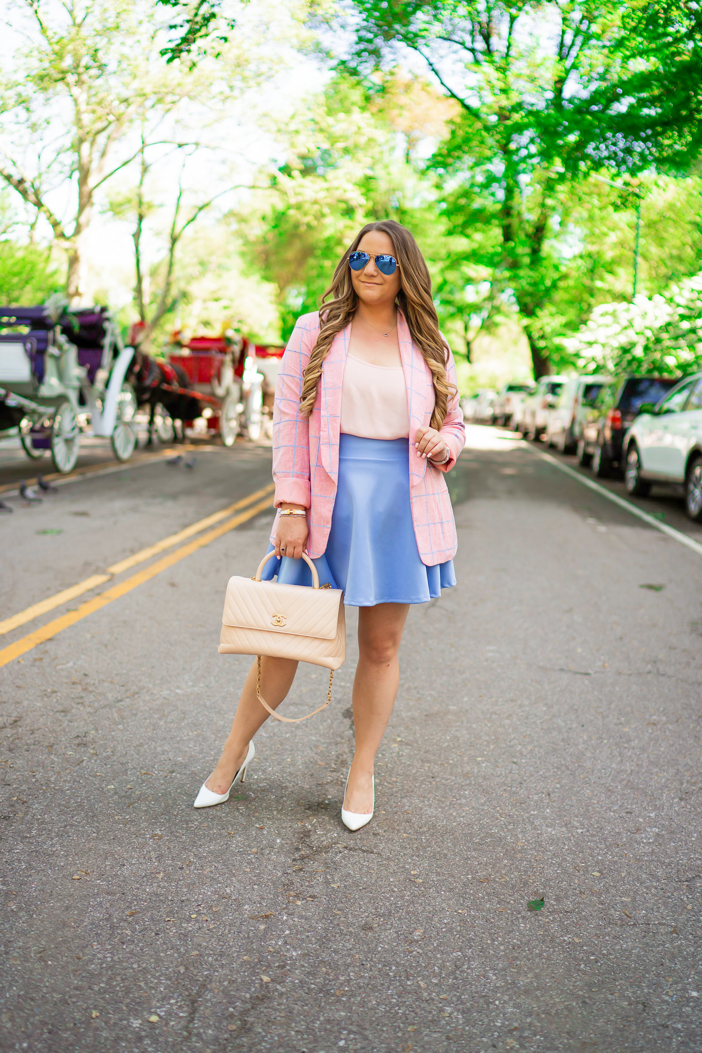 missyonmadison, missyonmadison blog, la blogger, missyonmadison instagram, currently wearing, style inspo, outfit inspo, outfit ideas, central park nyc, nyc blogger, travel blogger, checkered blazer, blue skater skirt, amazon fashion, white pumps, white pointed toe pumps, beige chanel bag, chanel top handle bag, pink chiffon camisole, chanel bag, hair extensions, nyc street style,