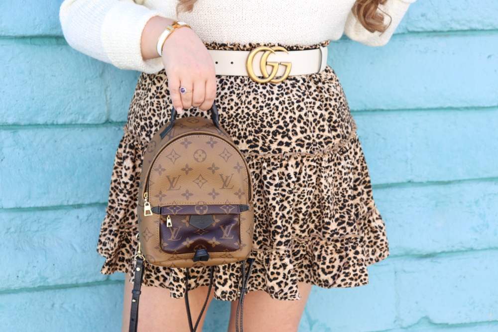 missyonmadison, missyonmadison blog, la blogger, missyonmadison instagram, melissa tierney, melissa tierney blog, fashion blog, fashion blogger, style blog, style blogger, fall style, fall style 2019, fall style inspo, leopard skirt, styling leopard for fall, leopard fall style, hermes sandals, hermes shoes, hermes oran sandals, louis vuitton bag, louis vuitton palm spring backpack, lv backpack, bag borrow steal, bag borrow steal review, gucci belt, white gucci belt, white cropped sweater, white sweater, leopard skater skirt,